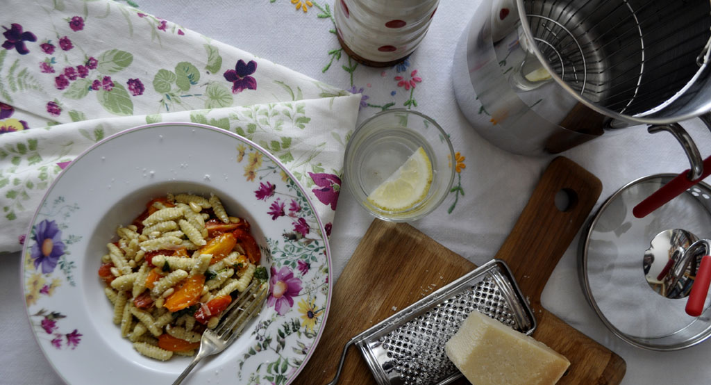 Home-made pasta with tomatoes and pine nuts